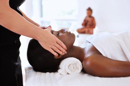 massaging head of black woman